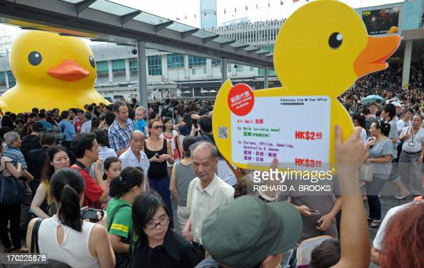Thousands of people crowd the waterfront on the last day to see a giant duck conceived by Dutch artist Florentijn Hofman in Hong Kong on June 9 2013...