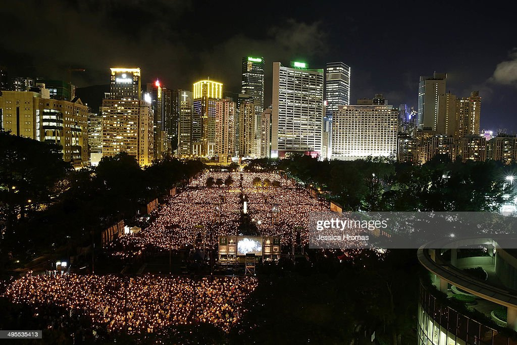 Thousands of people crowd Victoria Park to mark the 25th anniversary of Tiananmen Square protests with a candle light vigil on June 4 2014 in Hong...