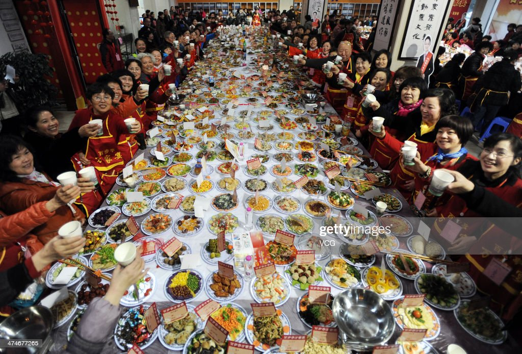 Thousands of people gather during a new year banquet at a residential community on January 24, 2014 in Wuhan, Hubei Province of China.