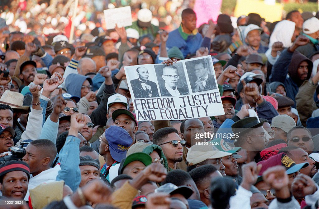 Thousands of people gather on the Mall in front of the US Capitol during the 'Million Man March' in Washington D.C., 16 October 1995. The march, called by Nation of Islam leader Louis Farrakhan, is intended as a day for back men to unite and pledge self-reliance and commitment to their families and communities.