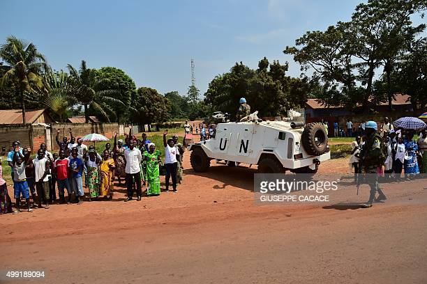 Thousands of people gather on the street to wait for the arrival of Pope Francis in Bangui on November 29 2015 Pope Francis arrived as 'a pilgrim of...