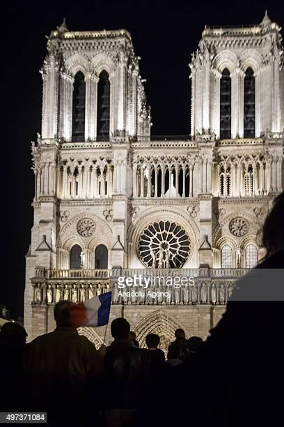 Thousands of people gather oustide Notre Dame Cathedral during a mass in Paris France 15 November 2015 At least 129 people were killed and over 352...