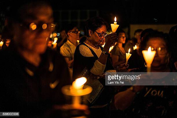 Thousands of people hold candles during a candlelight vigil on June 4 2016 in Hong Kong Hong Kong Thousands of people in Hong Kong participated in an...