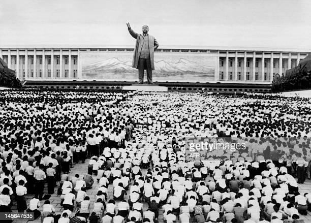 Thousands of people kneel down or stand in front of a giant statue of North Korean President Kim Il Sung to mourn the death of late President at the...