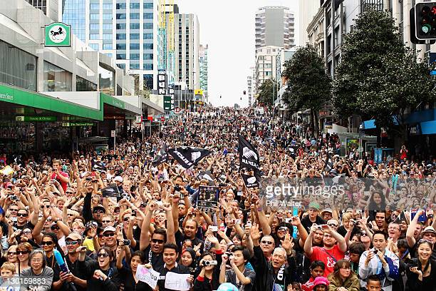 Thousands of people line the streets to watch the New Zealand All Blacks 2011 IRB Rugby World Cup celebration parade on October 24 2011 in Auckland...