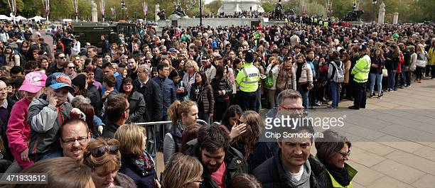 Thousands of people line up for a chance to glimpse and photograph the announcement of the birth of Prince William Duke of Cambridge and the Duchess...