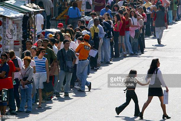 Thousands of people line up to apply for jobs in the public health sector 29 July 2003 in downtown Sao Paulo Brazil According to IBGE institute the...