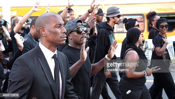 Thousands of people march and shout slogans on Hollywood Boulevard to protest the jury decisions not to indict police officers killed black people on...