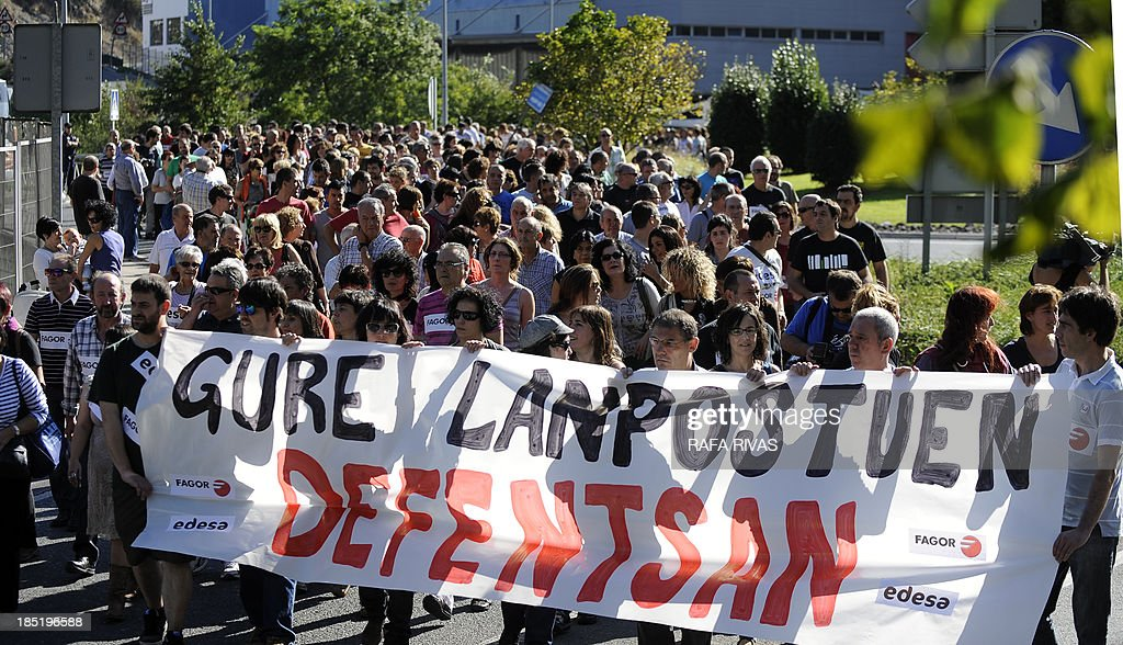 Thousands of people march behind a banner reading 'In defense of our jobs' during a demonstration called by workers of Spanish electrical appliance maker Fagor which has filed for protection from creditors, on October 18, 2013, in the northern Spanish Basque town of Mondragon. The maker of everything from small appliances to washing machines, fridges and kitchen furniture said it had started negotiations to restructure its debt, estimated by the Spanish media at 800 million euros ($1.1 billion).