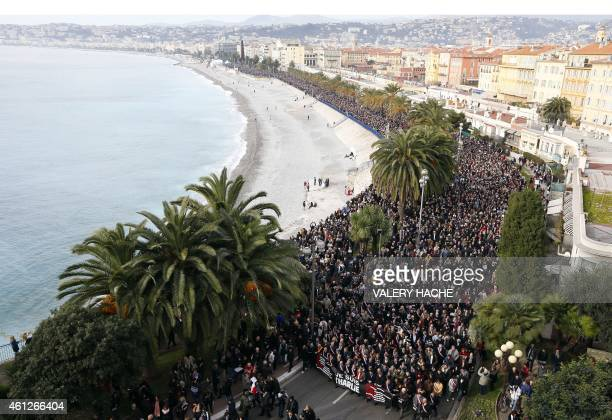 Thousands of people march during a rally along the sea front in Nice on January 10 2015 in remembrance for the victims of an attack by armed gunmen...