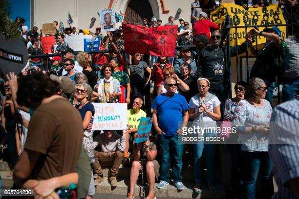 Thousands of people march through the city centre to the South African Parliament waving South African flags and banners to call for South African...