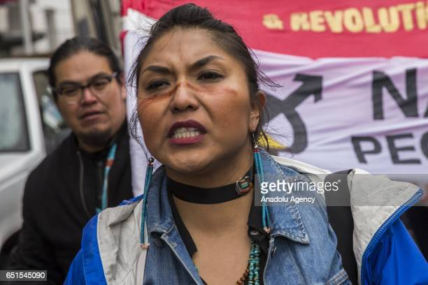 Thousands of people march through Washington to the White House protesting the construction of the Dakota Access Pipeline with members of the...