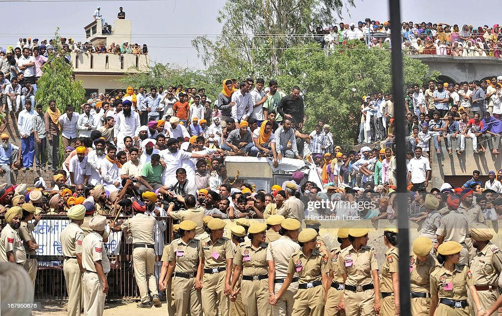 Thousands of people paid tribute to Sarabjit Singh during his cremation ceremony at his native village Bikhiwind on May 3, 2013 about 40 Kms from Amritsar, India. Sarabjit Singh, an Indian prisoner in Pakistan who died after being brutally assaulted in a Pakistani jail, was cremated in his native village with full state honours .