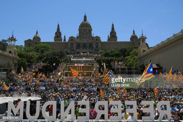 Thousands of people participate in a demonstration dubbed 'Referendum is Democracy' organized by ANC AMI and Omnium Cultural in Barcelona on June 11...