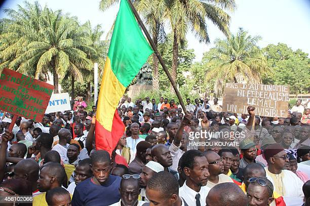 Thousands of people participate in a march September 25 2014 in Bamako demanding peace in Mali and to protest calls for independence in the north by...