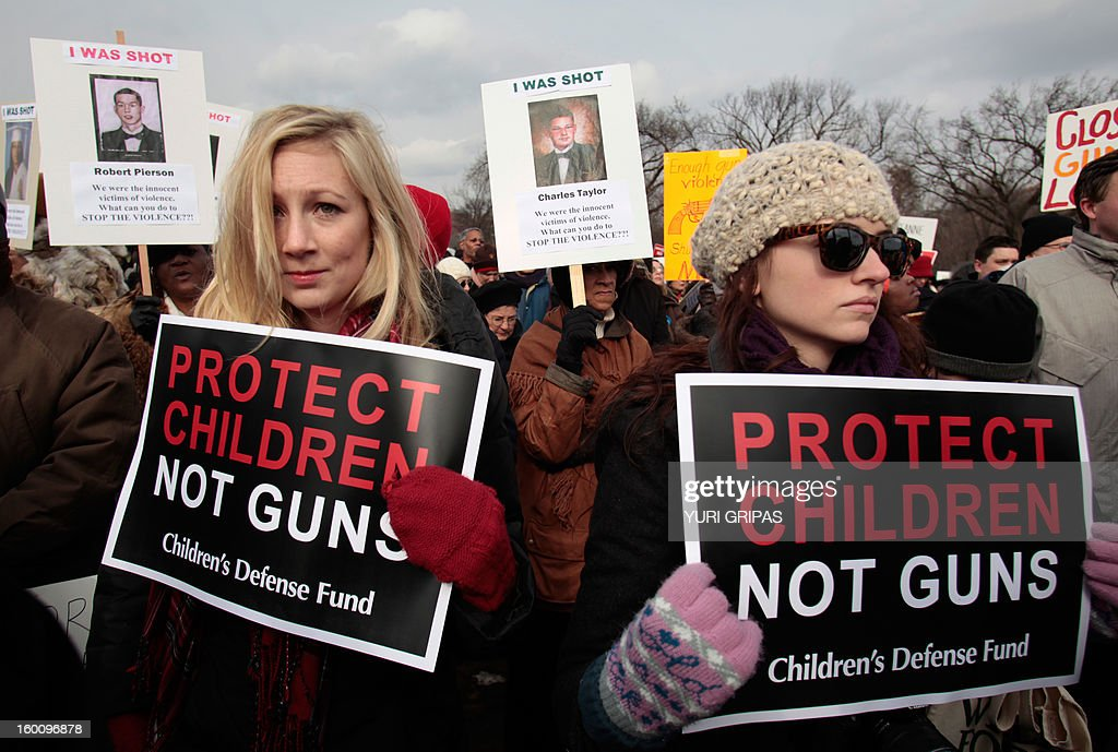 Thousands of people participate in the March on Washington for Gun Control on January 26, 2013 in Washington in response to last month's school shooting in Newtown, Connecticut.