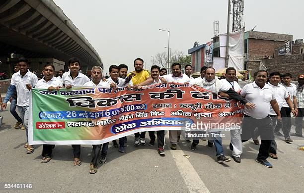 Thousands of people participate in the Run for Development celebration the achievements of two years of Modiled government from Khajoori Chowk to...