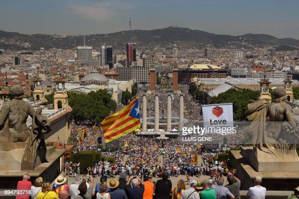 Thousands of people participatein a demonstration dubbed 'Referendum is Democracy' organized by ANC AMI and Omnium Cultural in Barcelona on June 11...