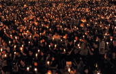 Thousands of people take part in a candlelight vigil in Victoria Park in Hong Kong on June 4 2009 to mark the 20th anniversary of Beijing's crackdown...