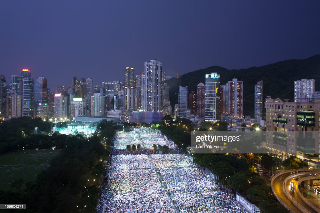 Thousands of people take part in a candlelight vigil on the 24th anniversary of the Tiananmen Square protests during heavy rain on June 4, 2013 in Hong Kong, Hong Kong. Held to mark the crackdown on the pro-democracy movement in Beijing's Tiananmen Square on June 4, 1989.Pro-democracy groups hope to draw 150,000 people to the annual candlelight vigil in Hong Kong's Victoria Park, the only commemoration on Chinese soil.