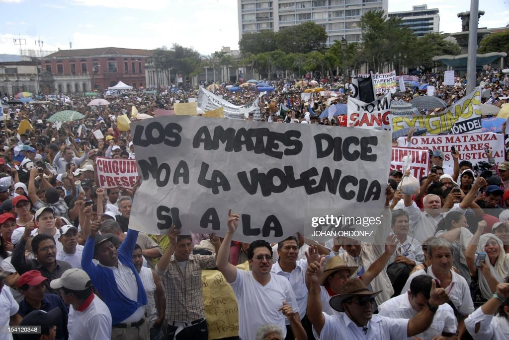 Thousands of people take part in the 'Life and dignity' march in Guatemala City on October 14 following the killing last week of eight indigenous...