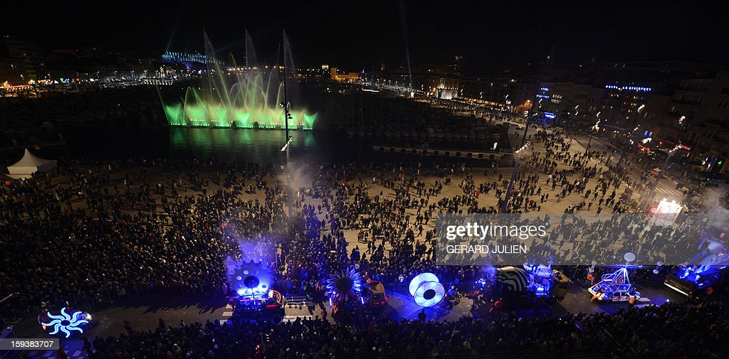 Thousands of people take part in the light parade on January 12, 2013 in the Vieux-Port harbour of French southern city of Marseille, part of the launching of Marseille-Provence 2013 European Capital of Culture. The event marks the start of a year, leading to a cultural renaissance in France's second-largest metropolitan area.