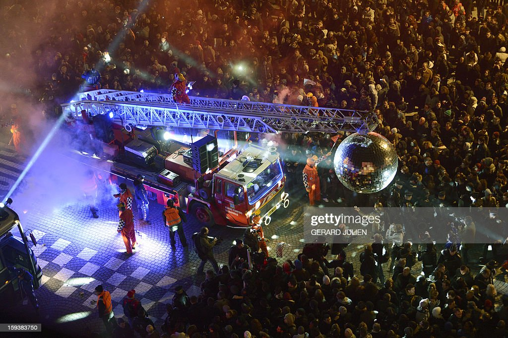 Thousands of people take part in the light parade on January 12, 2013 in the Vieux-Port harbour of French southern city of Marseille, part of the launching of Marseille-Provence 2013 European Capital of Culture. The event marks the start of a year, leading to a cultural renaissance in France's second-largest metropolitan area. AFP PHOTO / GERARD JULIEN