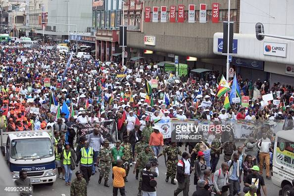 Thousands of people take part in the 'peace march' against xenophobia in Durban South Africa on April 16 2015 South African President Jacob Zuma on...