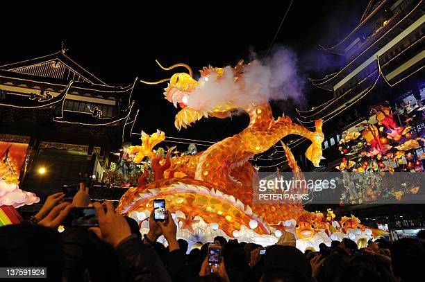 Thousands of people visit a lantern festival to celebrate the Chinese New Year of the Dragon in Shanghai on January 23 2012 The Lunar New Year begins...