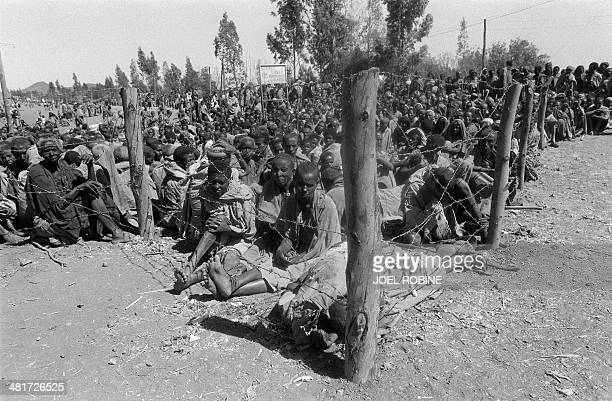 Thousands of people wait for food and medical care at a refugee camp near Korem in Northern Ethiopia on January 19 1985 Thousands of inhabitants in...