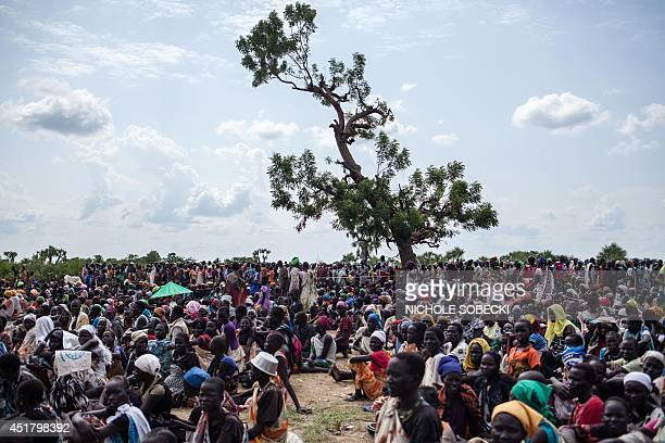 Thousands of people wait in the hot sun near the air drop zone in Leer South Sudan on July 5 2014 Over 40 tons of emergency food supplies and seed...