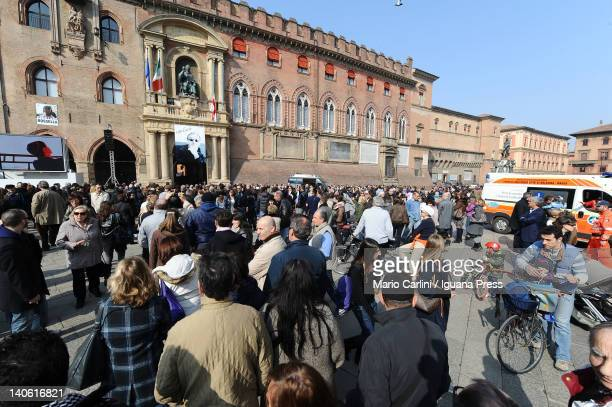 Thousands of people wait to visit the coffin of Lucio Dalla in the Courtyard of Honour in the Palazzo D'Accursio at Piazza Maggiore on March 3 2012...
