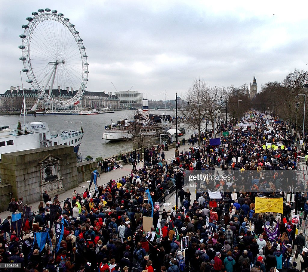 Thousands of people walk along the Embankment past the Millenium Wheel towards Hyde Park as they participate in an antiwar protest march February 15, 2003 in London, England. The march is believed to be the UK's biggest ever peace protest. Massive demonstrations are taking place in Europe, North America and Australia today against a possible U.S.-led war on Iraq.