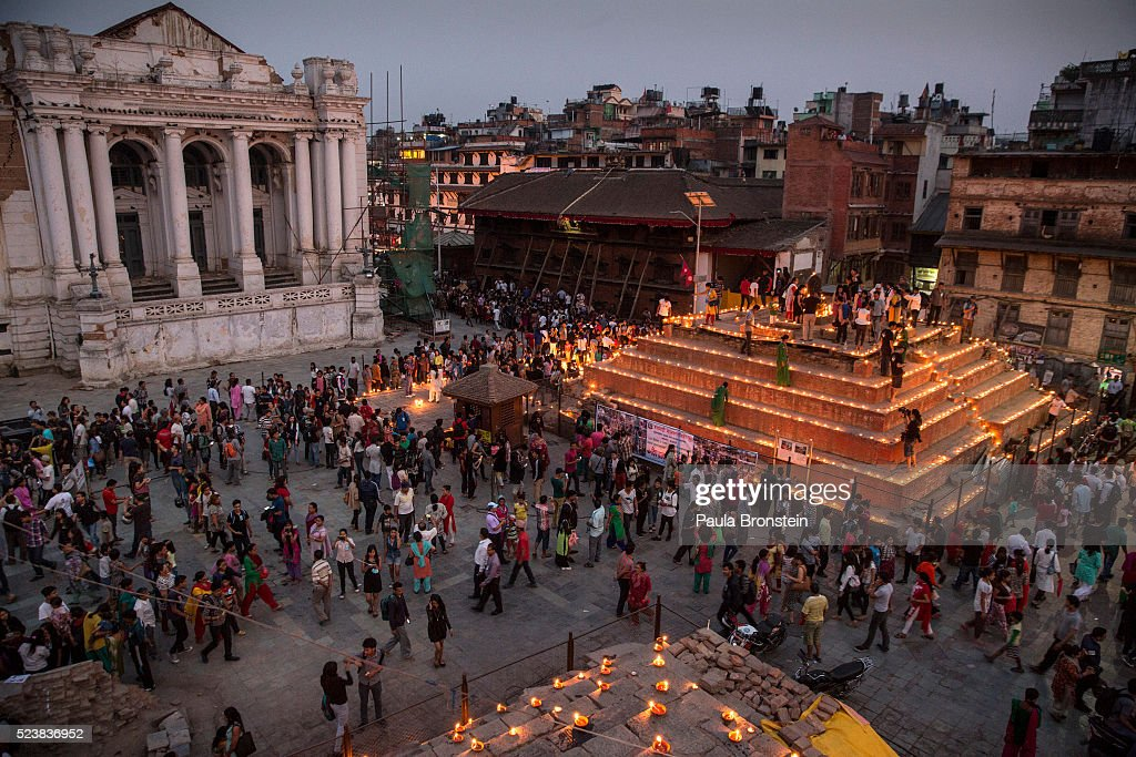 Thousands of people walk around Durbar square during a candle lighting ceremony for the anniversary of the Nepal earthquake in Kathmandu, Nepal. The April 2015 earthquake killed nearly 9,000 people and injured more than 22,000.