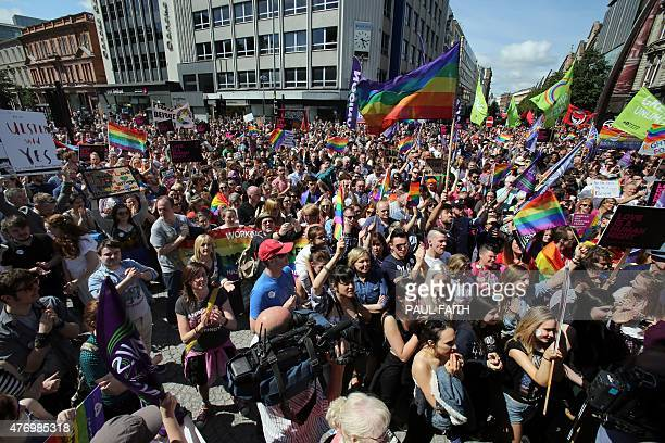Thousands of people walk through Belfast city centre to city hall at a rally for gay marriage rights on June 13 2015 following the Yes vote in last...