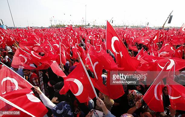 Thousands of people wave Turkish flags during an antiterror rally at Yenikapi area in Istanbul Turkey on September 20 2015