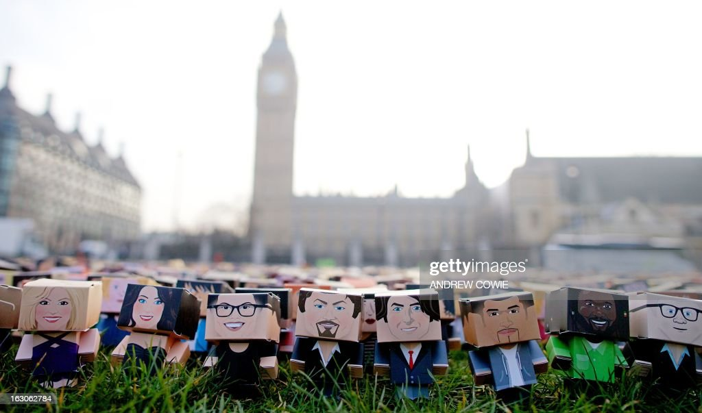 Thousands of personalised cardboard characters are pictured outside Britain's Houses of Parliament in central London, on March 4, 2013, during a photocall organised by Fairtrade Foundation, calling on British Prime Minister David Cameron to put smallholder farmers around the world at the heart of its trade policy ahead of the G8 Summit in June. The cardboard characters are generated by those who have signed an online petition. AFP PHOTO / ANDREW COWIE