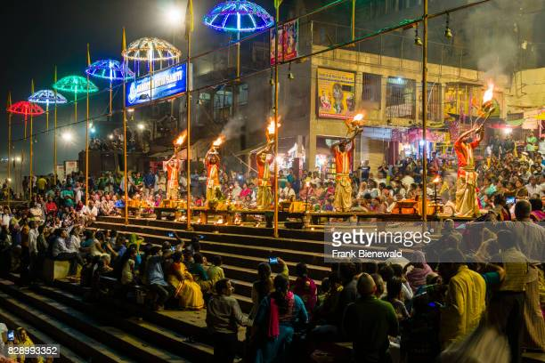 Thousands of pilgrims are watching Aartii a religious ceremony performed every evening at Dashashwamedh Ghat Main Ghat in the suburb Godowlia