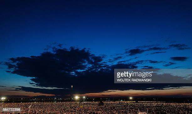 TOPSHOT Thousands of pilgrims light candles as they take part in a night vigil held by Pope Francis at Campus Misericordiae on July 30 2016 in Brzegi...