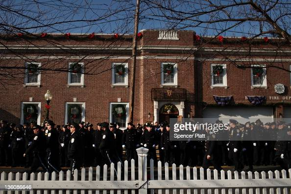 Thousands of police officers from around the state attend the funeral of New York City Police officer Peter Figoski who was killed last week while...