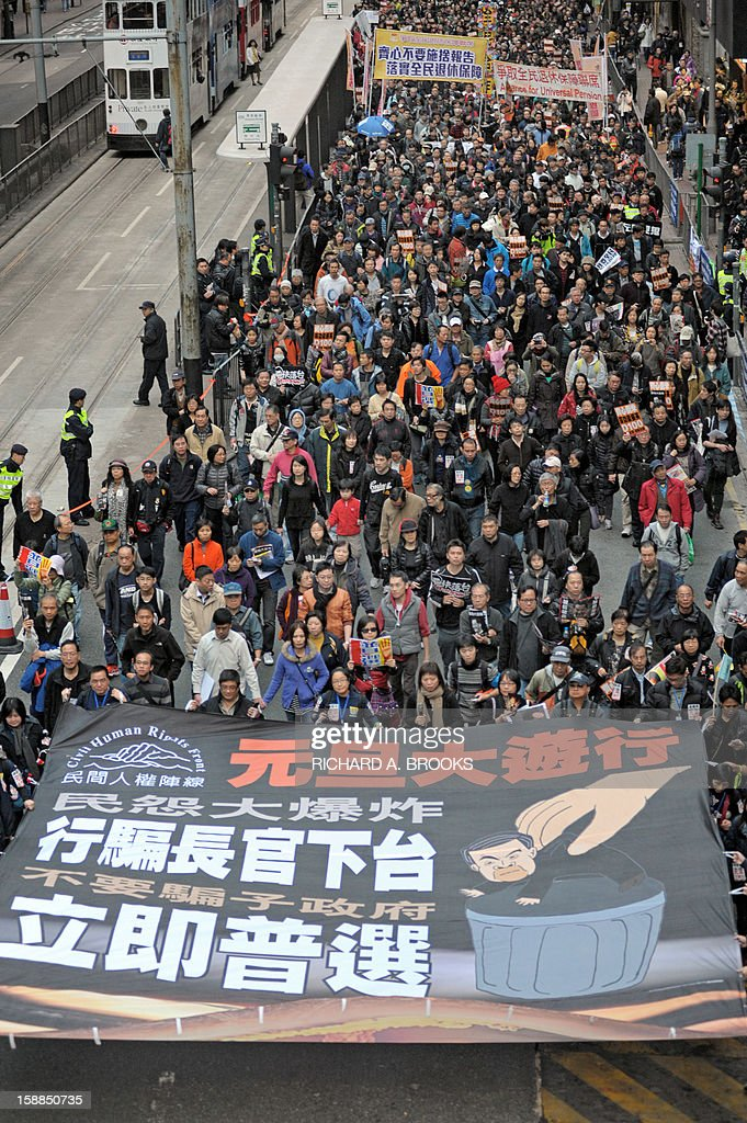 Thousands of pro-democracy protesters take to the streets calling for new Hong Kong Chief Executive Leung Chun-ying to step down in Hong Kong on January 1, 2013. Organisers have said they expected 50,000 people to join the New Year's Day march against Leung Chun-ying, while pro-government groups staged separate and smaller rallies in support of the Beijing-backed chief executive.