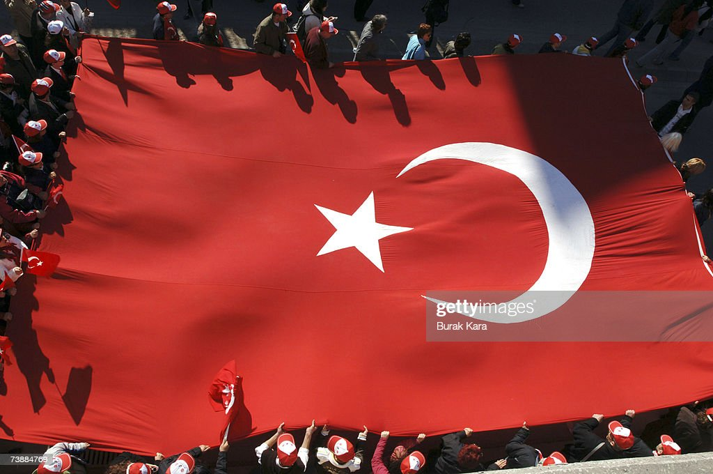 Thousands of prosecularist Turks holding their national flags attend a rally against Turkish Prime Minister Tayyip Erdogan's possible candidacy to...