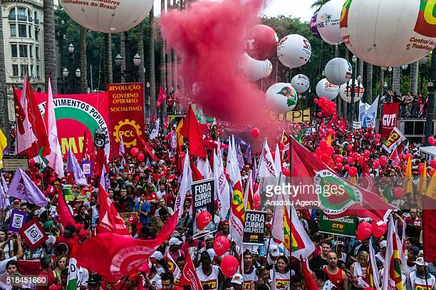 Thousands of protesters holding banners and posters attend a demonstration to support the current government of President Dilma Rousseff in front of...