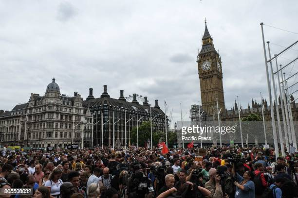 Thousands of protesters march through London and rally in Parliament Square calling for a change in government and an end to austerity