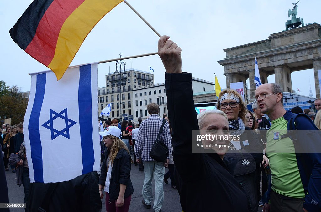 Thousands of protesters organized by Germanys Jewish community attend the rally against antisemitism entitled 'Stand Up Jew Hatred Never Again' at...