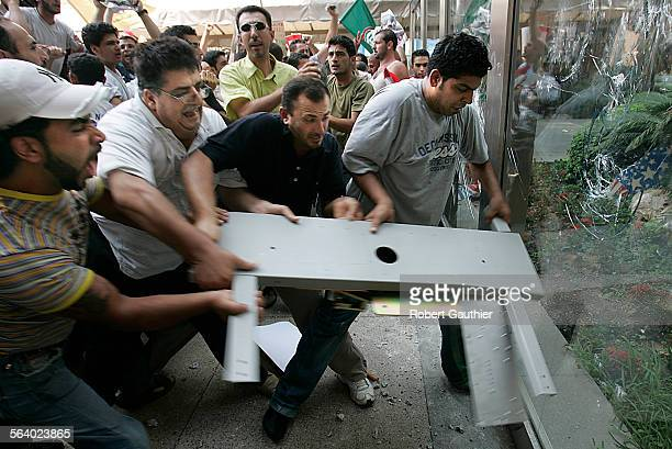 Thousands of protestors stormed the UN building in downtown Beirut hours after an Israeli airstrike killed more than 50 refugees gathered in a...