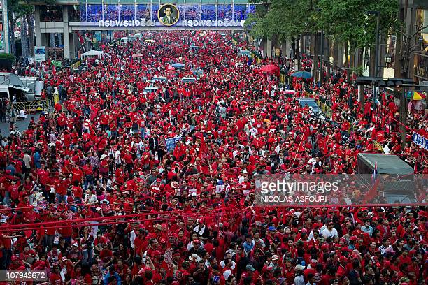 Thousands of 'Red Shirt' antigovernement protesters rally at Ratchaprasong intersection in Bangkok on January 9 2011 The Red Shirts rallied in...