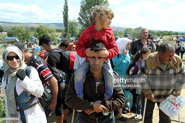 Thousands of refugees from Syria Iraq and Afghanistan wait to be transported to the inside of Serbia in a temporary center for refugees on the border...