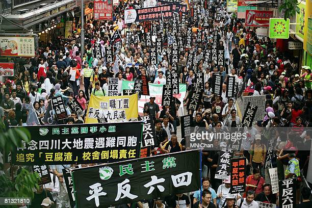 Thousands of residents attend a prodemocracy march to mark the 19th anniversary of the massacre which took place during the Tiananmen Square protests...