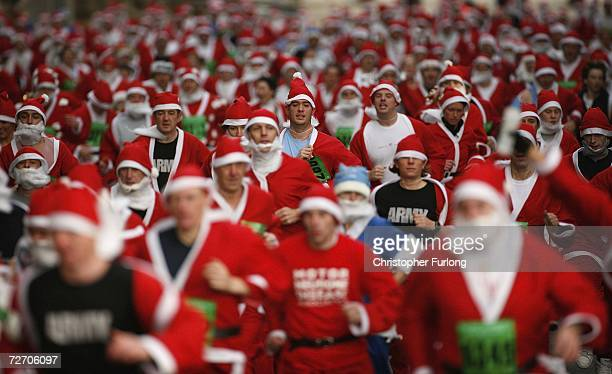 Thousands of runners dressed as Santa Claus take to the streets of Liverpool during the city's annual Santa Dash in aid of charity on December 3 2006...